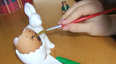 carefully painting eggs