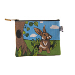 Rabbit sitting beside tree purse