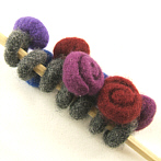 Felted ring in the shape of a rose
